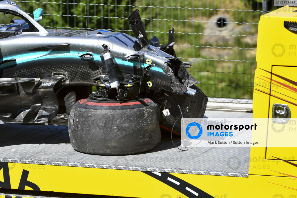 The damaged car of Valtteri Bottas, Mercedes AMG W10, on a flat bed truck after his crash at turn 6
