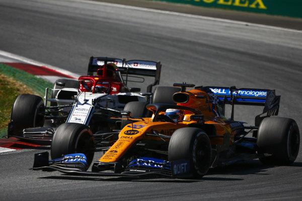 Carlos Sainz Jr., McLaren MCL34, leads Kimi Raikkonen, Alfa Romeo Racing C38