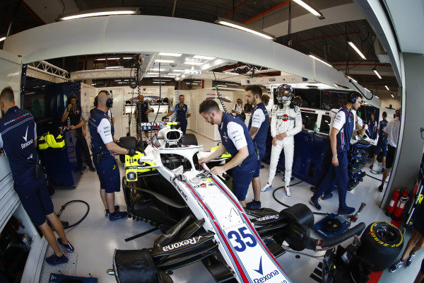 Sergey Sirotkin, Williams Racing, prepares for FP1 in the team's garage.
