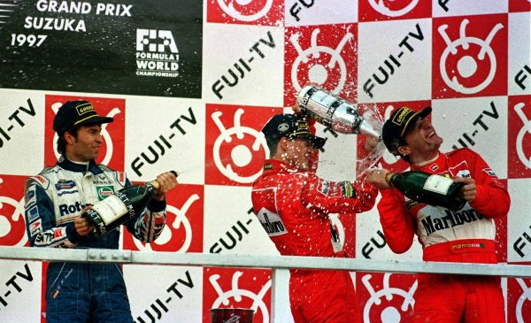 1997 Japanese Grand Prix.Suzuka, Japan.10-12 October 1997.Michael Schumacher, Eddie Irvine (both Ferrari) and Heinz-Harald Frentzen (Williams Renault) after finishing in 1st, 3rd and 2nd positions respectively.World Copyright - LAT Photographic