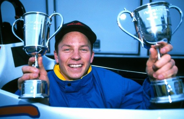 Kimi Raikkonen (FIN) Manor Motorsport shows off the trophies he received for winning all the races in the series.