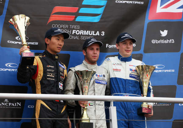 Brands Hatch, Kent. 10th - 11th August 2013.  Sun Zheng, CF, Ed Jones, West-Tec, and Cameron Twynham, West-Tec, celebrate on the podium.  Ref: IMG_3327a. World Copyright: Kevin Wood/LAT Photographic