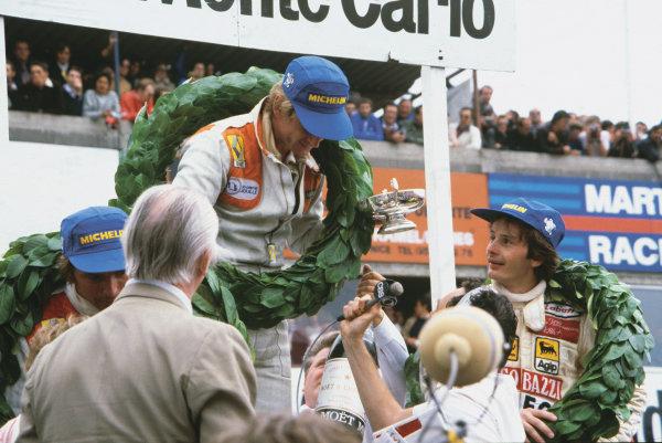 Dijon-Prenois, France. 29 June-1 July 1979.Jean-Pierre Jabouille (Renault RS10) 1st position with Gilles Villeneuve (Ferrari 312T4) 2nd position and Rene Arnoux (Renault RS10) 3rd position, on the podium, portrait.World Copyright: LAT Photographic.Ref: 79FRA44