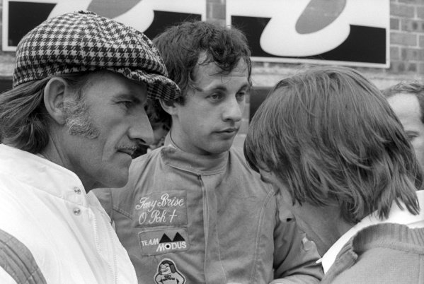 Graham Hill (GBR) Embassy Hill Racing Team Owner (Left) with his protégé Tony Brise (GBR) Embassy Hill Racing (Centre), who qualified in his second GP an excellent seventh, but retired from the race on lap 17 with a blown engine. Ray Brimble (GBR) Embassy Hill Team Manager (Right).