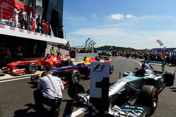 Silverstone, Northamptonshire, England 30th June 2013 The cars of Nico Rosberg, Mercedes W04, 1st position, Mark Webber, Red Bull RB9 Renault, 2nd position, and Fernando Alonso, Ferrari F138, 3rd position, beneath the podium World Copyright: Chris Bird/  ref: Digital Image _DSC2189
