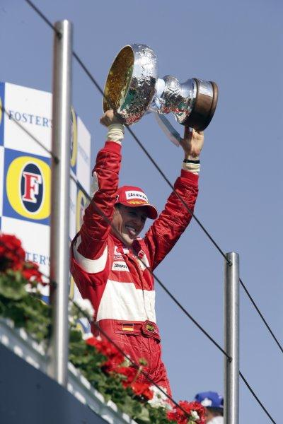 2006 San Marino Grand Prix - Sunday Race Imola, Italy. 20th - 23rd April 2006 Michael Schumacher, Ferrari 248F1, 1st position, podium. World Copyright: Charles Coates/LAT Photographic ref: Digital Image ZK5Y0460