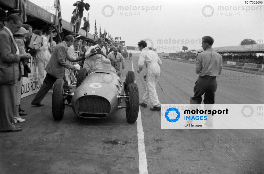 Reg Parnell, BRM P15, is refuelled during a pitstop.