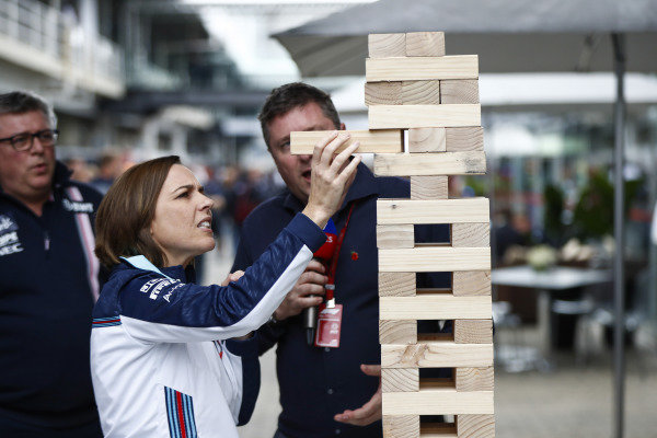 Claire Williams, Deputy Team Principal, Williams Racing, takes on Otmar Szafnauer, Team Principal, Racing Point Force India, in a giant Jenga game with David Croft, Sky Sports F1, observing