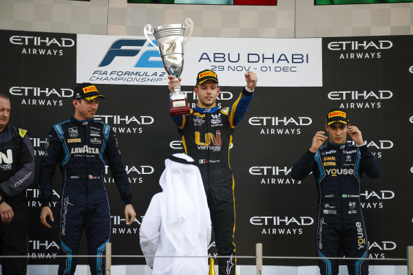 Luca Ghiotto (ITA, UNI VIRTUOSI), celebrates victory on the podium with Nicholas Latifi (CAN, DAMS) and Sergio Sette Camara (BRA, DAMS)