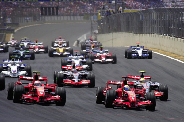Felipe Massa, Ferrari F2007 leads Kimi Räikkönen, Ferrari F2007 and Lewis Hamilton, McLaren MP4-22 Mercedes at the start.