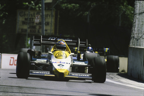 Keke Rosberg, Williams FW09 Honda, leads Derek Warwick, Renault RE50.