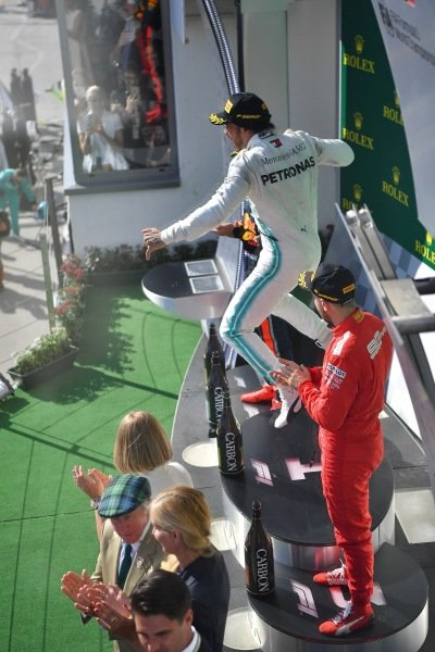 Lewis Hamilton, Mercedes AMG F1, 1st position, leaps in celebration on the podium