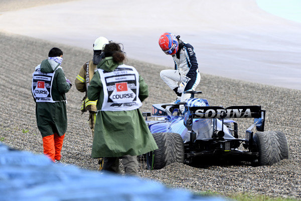 George Russell, Williams FW43B, climbs out of his car after beaching in the gravel during FP3