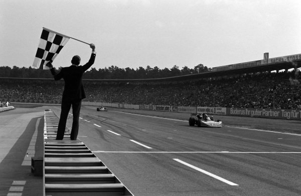 Hans-Joachim Stuck, March 742 BMW/Rosche, crosses the finish line and takes the chequered flag for victory.