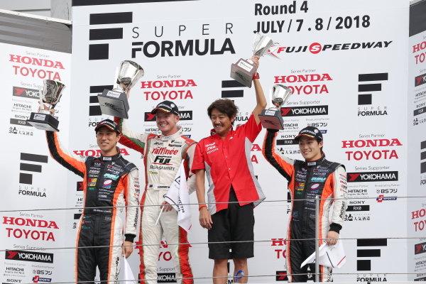 Winner Nick Cassidy, number three ORIENTALBIO KONDO SF14 Toyota, celebrates on the podium, with  Hiroaki Ishiura, number one JMS P.MU/CERUMO・INGING SF14 Toyota, second position, and Yuji Kunimoto, JMS P.MU/CERUMO・INGING SF14 Toyota, third position.