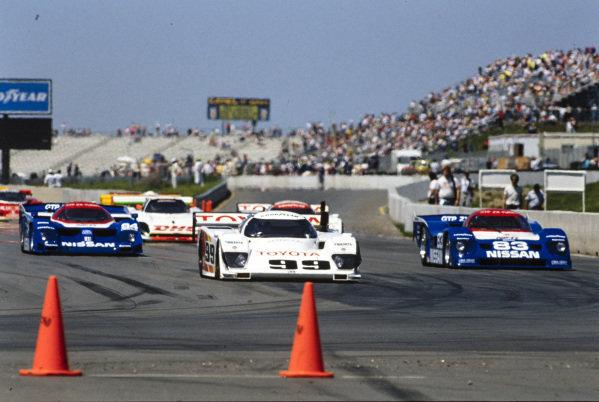 Rocky Moran / Drake Olson / Juan Manuel Fangio II, All American Racers, Eagle HF-89 Toyota, leads Derek Daly / Bob Earl, Nissan GTP ZX-T, and Geoff Brabham / Chip Robinson, Nissan GTP ZX-T.