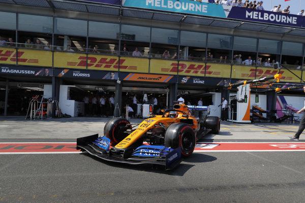 Carlos Sainz Jr., McLaren MCL34, leaves the garage