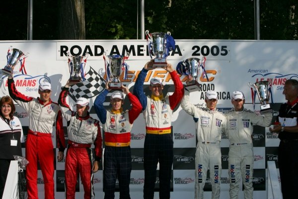 GT2 podium and results: 1st: Patrick Long (USA) / Jorg Bergmeister (GER) Petersen/White Lightning, centre. 2nd: Timo Bernhard (GER) / Romain Dumas (FRA) Alex Job Racing, right. 3rd: Johannes van Overbeek (USA) / John Fogarty (USA) Flying Lizard Motorsports, left. American Le Mans Series, Rd7, Road America, Elkhart Lake, USA, 19-21 August 2005. DIGITAL IMAGE