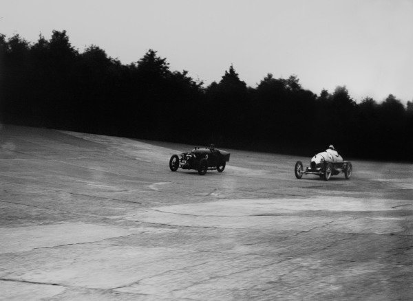 Brooklands, England. June 1923.A Morgan and a Wolseley in action.World Copyright: LAT Photographic.Ref: Autocar Glass Plate A1775.