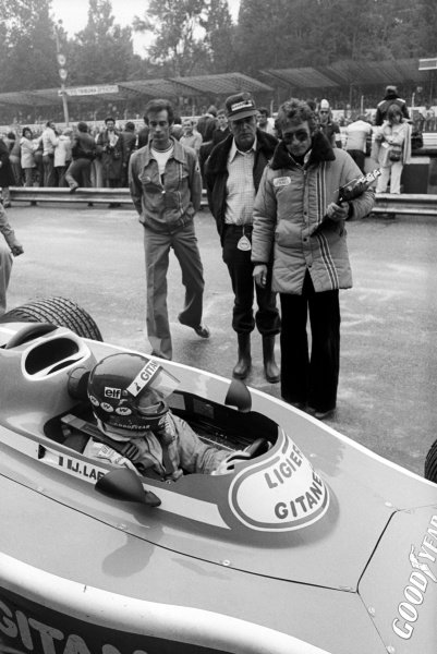 Jacques Laffite (FRA) Ligier JS5, took his and the team's first pole position, finishing the race in third position. Gerard Ducarouge (FRA) Ligier Team Manager is nearest the car in the pits.Italian Grand Prix, Rd 13, Monza, Italy, 12 September 1976.