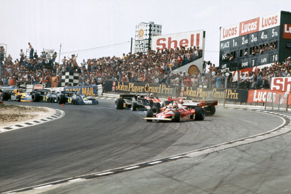 Brands Hatch, England. 16th - 18th July 1976. Clay Regazzoni (Ferrari 312T2), Disqualified, crashes into Niki Lauda (Ferrari 312T2), 1st position, at the top of Paddock Hill Bend with James Hunt (McLaren M23-Ford), Disqualified, causing the race to be stopped, action. World Copyright: LAT Photographic. Ref:  76 GB 06.