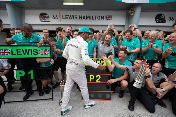 Sepang International Circuit, Sepang, Kuala Lumpur, Malaysia. Sunday 30 March 2014. Lewis Hamilton, Mercedes AMG, 1st Position, celebrates with his team. World Copyright: Steve Etherington/LAT Photographic. ref: Digital Image SNE10947 copy