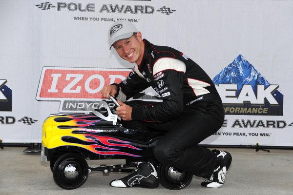 30 April-1 May, 2010, Kansas City, Kansas USA#6 Team Penske's Ryan Briscoe, Peak Pole award winner with Kansas Speedway's tradition peddle car for pole as well.©2010, Dan R. Boyd, USA LAT Photographic.