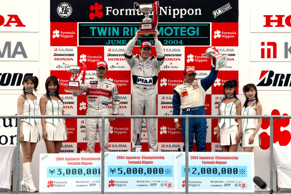 2004 Formula Nippon ChampionshipMotegi, Japan. 6th June 2004.Race winner, Andre Lotterer (PIAA Nakajima) 1st, Yufi Ide (Mobilecast IMPUL) 2nd and Tatsuya Kataoka (LeMans Spirit) 3rd. Podium.World Copyright: Yasushi Ishihara/LAT Photographicref: Digital Image Only