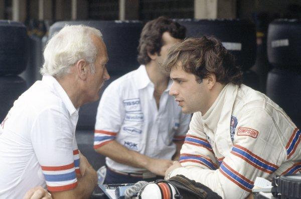 1980 Brazilian Grand Prix.Interlagos, Sao Paulo, Brazil. 25-27 January 1980.Colin Chapman and Elio de Angelis (Lotus 81-Ford Cosworth), 2nd position. Portrait.World Copyright: LAT PhotographicRef: 35mm transparency 80BRA11