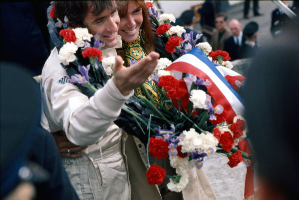 Clermont-Ferrand, France. 6 July 1969 Jackie Stewart, Matra MS80-Ford, 1st position, with his wife, Helen on the podium, portrait World Copyright: LAT Photographic. Ref: 69FRA27.