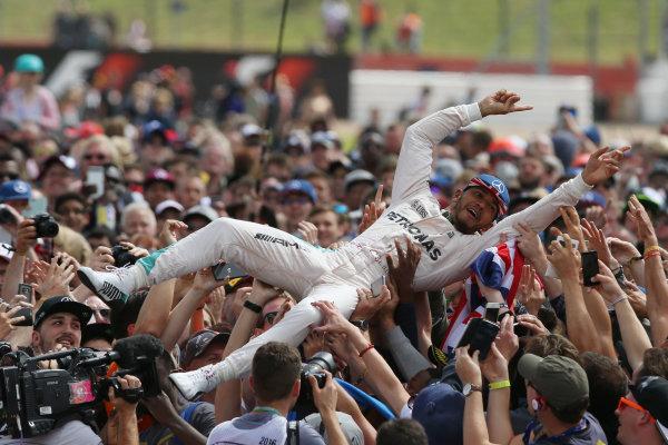 Silverstone, Northamptonshire, UK Sunday 10 July 2016. Lewis Hamilton, Mercedes AMG, crowd surfs after victory. World Copyright: Ebrey/LAT Photographic ref: Digital Image Hamilton-03