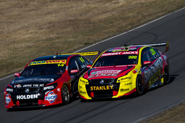 2015 V8 Supercar Championship Round 2.  Tasmanian Super Sprint, Symmons Plains Raceway, Tasmania, Australia. Friday 27th March to Sunday 29th March 2015. Fabian Coulthard drives the #14 Freightliner Racing Holden VF Commodore passes Tim Slade drives the #47 Supercheap Auto Racing Holden VF Commodore  World Copyright: Daniel Kalisz/LAT Photographic Ref: Digital Image V8SC15_AGP_DKIMG3015.CR2