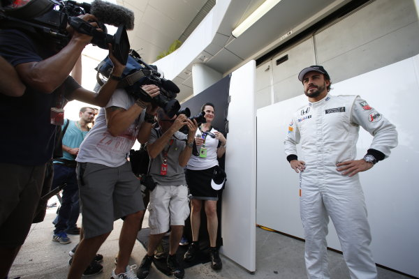Sepang International Circuit, Sepang, Kuala Lumpur, Malaysia. Thursday 26 March 2015. Fernando Alonso, McLaren, poses for his portrait in front of the media. World Copyright: Glenn Dunbar/LAT Photographic. ref: Digital Image _W2Q5351