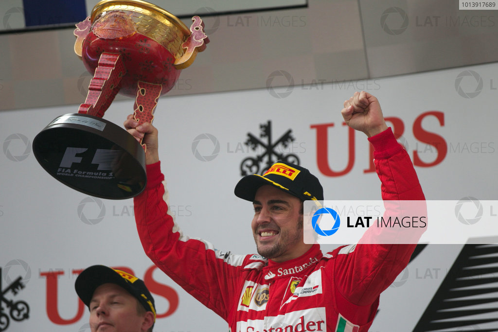 Shanghai International Circuit, Shanghai, China Sunday 14th April 2013 Fernando Alonso, Ferrari, 1st position, celebrates on the podium with his trophy. World Copyright: Andy Hone/LAT Photographic ref: Digital Image HONZ7877