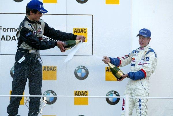 Champagne for race winner Michael Vorba (CZE), American Bull Racing, (left), and Sebastian Vettel (GER), Eifelland Racing (3rd, right). Formula BMW ADAC Championship, Rd18, Zandvoort, Holland. 21 September 2003. DIGITAL IMAGE