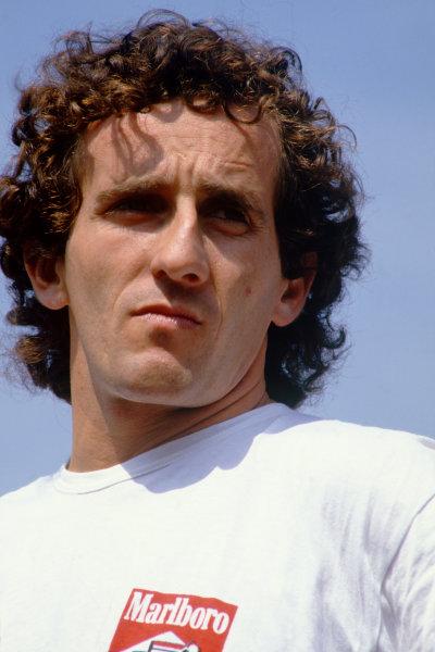 Monza, Italy. 6th - 8th September 1985.Alain Prost (McLaren MP4/2B-TAG Porsche) 1st position, portrait.  World Copyright: LAT Photographic.Ref:  85ITA