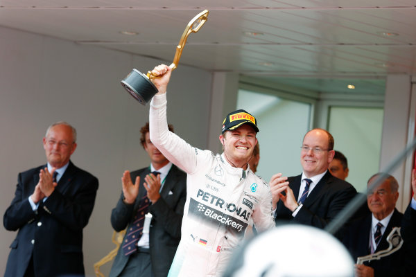 Monte Carlo, Monaco. Sunday 24 May 2015. Nico Rosberg, Mercedes AMG, 1st Position, celebrates on the podium with his trophy. World Copyright: Charles Coates/LAT Photographic. ref: Digital Image _N7T0441