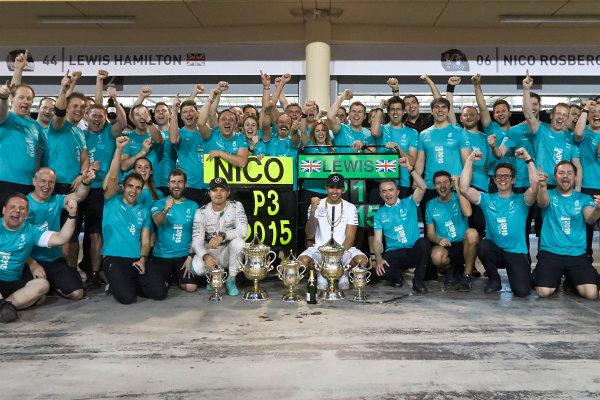 Bahrain International Circuit, Sakhir, Bahrain. Sunday 19 April 2015. Lewis Hamilton, Mercedes AMG, 1st Position, Nico Rosberg, Mercedes AMG, 3rd Position, and the Mercedes team celebrate victory. World Copyright: Steve Etherington/LAT Photographic. ref: Digital Image SNE24563