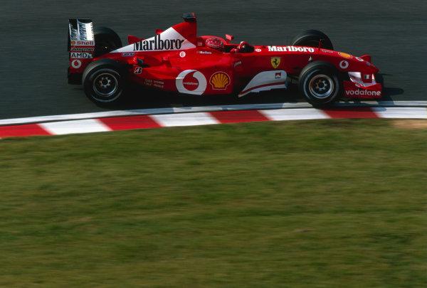 2002 Japanese Grand Prix.Suzuka, Japan. 11-13 October 2002.Michael Schumacher (Ferrari F2002).Ref-02 JAP 25.World Copyright - Lorenzo Bellanca/LAT Photographic