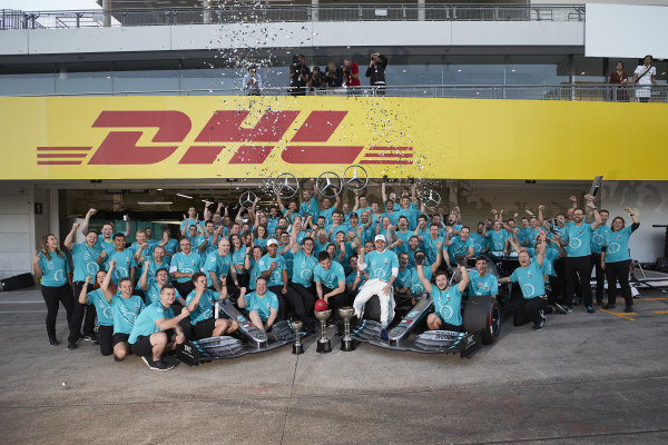 Valtteri Bottas, Mercedes AMG F1, Lewis Hamilton, Mercedes AMG F1 and Toto Wolff, Executive Director (Business), Mercedes AMG join other members of the AMG Mercedes F1 team celebrate winning the Constructors' World Championship