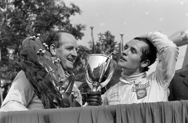 Denny Hulme, 1st position, on the podium with Jacky Ickx, 3rd position.