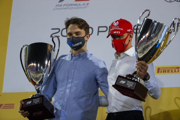 F2 and F3 Championship winners Oscar Piastri (AUS, PREMA RACING) and Mick Schumacher (DEU, PREMA RACING) on the podium with trophies