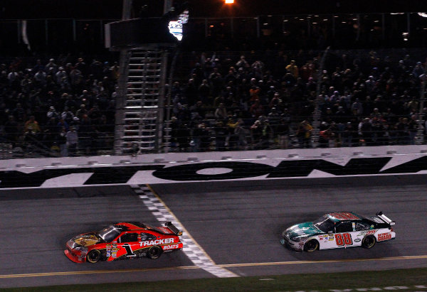 5-14 February, 2010, Daytona Beach, Florida, USAWinner Jamie McMurray crosses the finish line and takes the checkered flag with Dale Earnhardt Jr. in tow©2010, Michael L. Levitt, USALAT Photographic