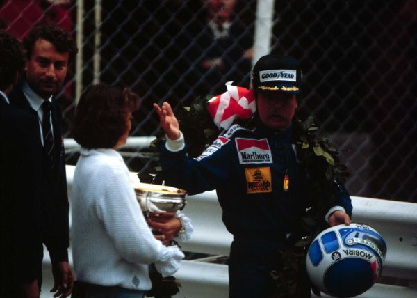 1983 Monaco Grand Prix. Monte Carlo, Monaco.12-15 May 1983.Keke Rosberg (Williams-Ford Cosworth) and his girlfriend Yvonne leave the podium after winning.World Copyright - LAT Photographic