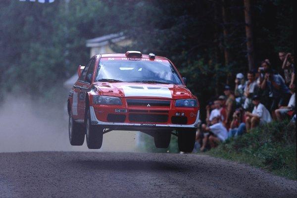 2002 World Rally ChampionshipNeste Rally of Finland. 8th - 11th August 2002.Jani Paasonen/Arto Kapanen, Mitsubishi Lancer WRC, action.World Copyright: McKlein/LAT Photographicref: 35mm Image A10