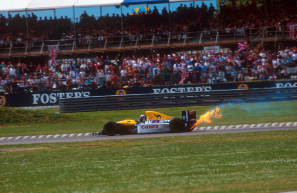 1993 British Grand Prix. Silverstone, England. 9-11 July 1993. Damon Hill (Williams FW15C Renault) retires from the race as his engine expires with a plume of flames. Ref-93 GB 13. World Copyright - LAT Photographic
