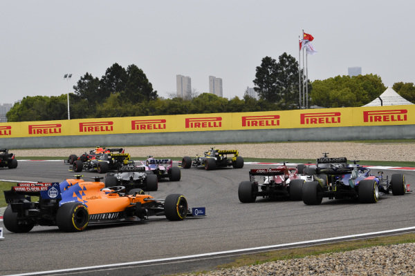Kimi Raikkonen, Alfa Romeo Racing C38, leads Daniil Kvyat, Toro Rosso STR14, Lando Norris, McLaren MCL34, and Carlos Sainz Jr., McLaren MCL34, at the start