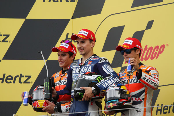 British Grand Prix.  Silverstone, England. 30th August - 1st September 2013.  Jorge Lorenzo, Yamaha, Marc Marquez and Dani Pedrosa, Honda, on the podium.  Ref: IMG_2567a. World copyright: Kevin Wood/LAT Photographic