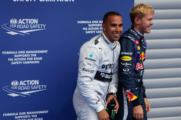 Spa-Francorchamps, Spa, Belgium. 24th August 2013. Lewis Hamilton, Mercedes AMG, and Sebastian Vettel, Red Bull Racing, share a joke after qualifying. World Copyright: Andrew Ferraro/LAT Photographic. ref: Digital Image _79P7713.