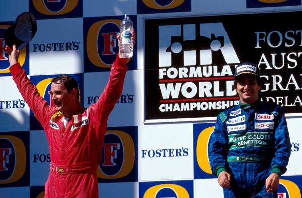 Second place Nigel Mansell(L) celebrates with winner Nelson Piquet